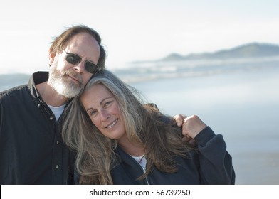 A retired husband and wife at the beach with copyspace on the right