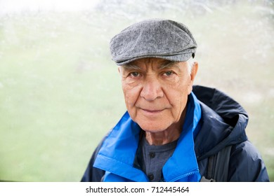 A retired man in hiking outfit in foggy weather