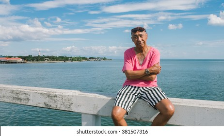 Retired old Asian man travel alone.