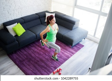 Retired old person, fitness and sports. Elderly latina woman working out at home. Active senior lady doing exercise and sport practice. Recreation, lifestyle, recreational activity