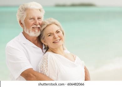 Retired senior male female Caucasian couple living a healthy outdoor island lifestyle on a Caribbean beach