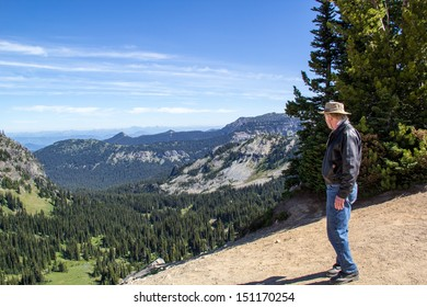 Retired senior man looking at view in Mt. Rainier National park Washington State USA