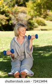 Retired woman doing her exercises in the park