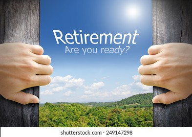 """Retirement concept. """"Retirement are you ready"""" word floating in the sky while 2 hands opening a wooden door to the new world."""