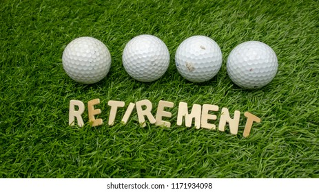 Retirement golf balls on green grass
