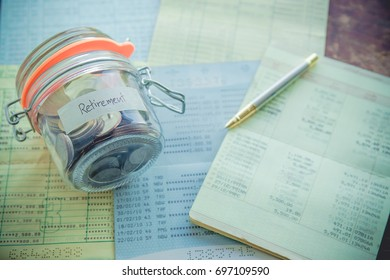 Retirement money in a jar and  saving account passbook