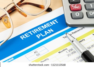 Retirement plan with glasses and calculator; document is mock-up