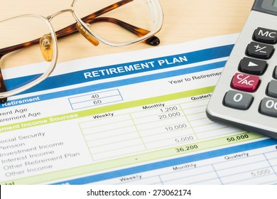 Retirement plan with glasses and calculator, document is mock-up