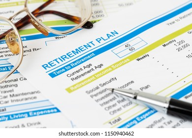 Retirement plan with glasses and pen, document is mock-up
