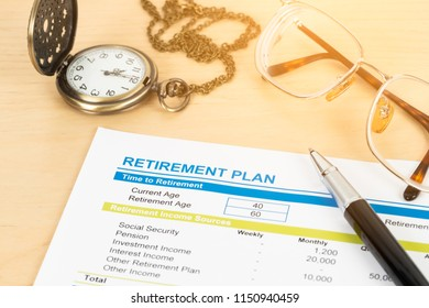 Retirement plan with glasses and pocket watch, document is mock-up