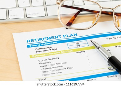 Retirement plan with keyboard and glasses, document is mock-up