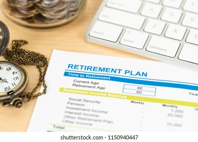 Retirement plan with keyboard and pocket watch, document is mock-up