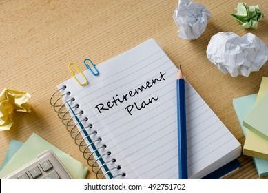 retirement plan on notebook on desk