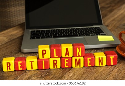 Retirement Plan written on a wooden cube in a office desk