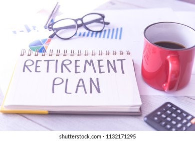 Retirement planning handwriting in a note book. Concept of starting senior investment pension retirement life.