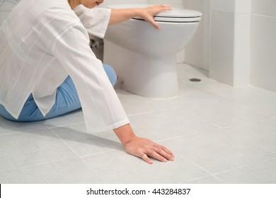 Retirement woman fell down in a restroom