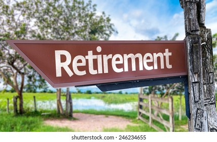 Retirement wooden sign with rural background