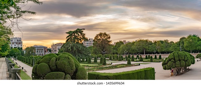 Retiro Park panorama, Madrid, Spain. Beautiful city garden during sunset.