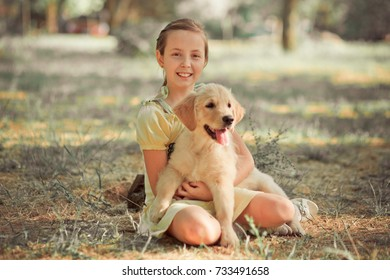 Retriever pup Lovely scene cute young teen girl enjoying posing summer time vacation with best friend dog ivory white labrador puppy.Happy airily careless childhood life world of dreams with puppies.