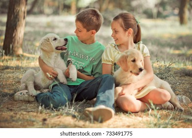 Retriever pup Lovely scene young teen sister brother enjoy posing summer time vacation with best friend dog ivory white labrador puppy.Happy airily careless childhood family life world dreams puppies