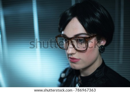Retro 1980s Business Woman In Front Of Blinds Office