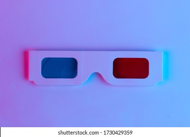 Retro 3d glasses from 80s in trendy neon light. Gradient pink-blue glow. Concept art. Pop culture 80s. Minimalism. Top view