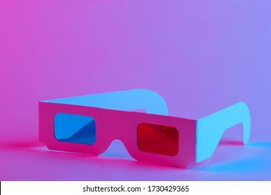 Retro 3d glasses from 80s in trendy neon light. Gradient pink-blue glow. Concept art. Pop culture 80s. Minimalism