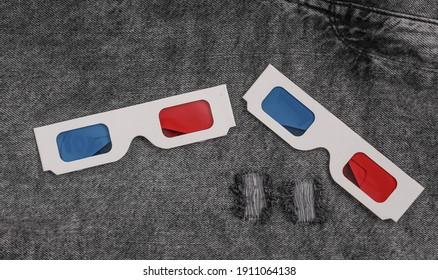 Retro 3d glasses on gray jeans
