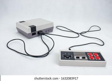 Retro 8-bit mini gaming console with gamepad