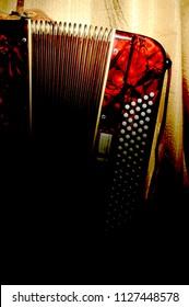 Retro accordion part in a darkness
