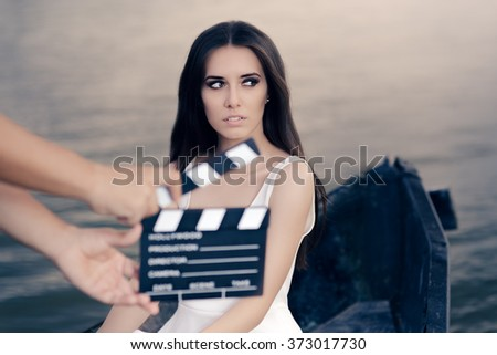 Retro Actress Shooting Movie Scene in a Boat - Young professional cinema star acting in a film