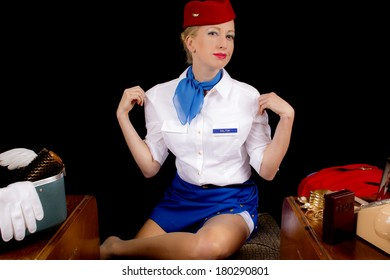 Retro Airline Stewardess or Flight Attendant After Removing Her Jacket.
