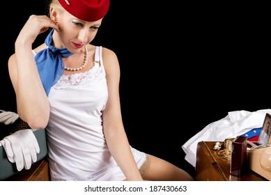 Retro Airline Stewardess or Flight Attendant in Lingerie.