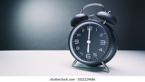 A retro alarm clock with bells showing six o'clock. Copy space available.