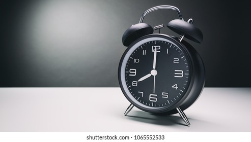 A retro alarm clock with bells showing eight o'clock. Copy space available.