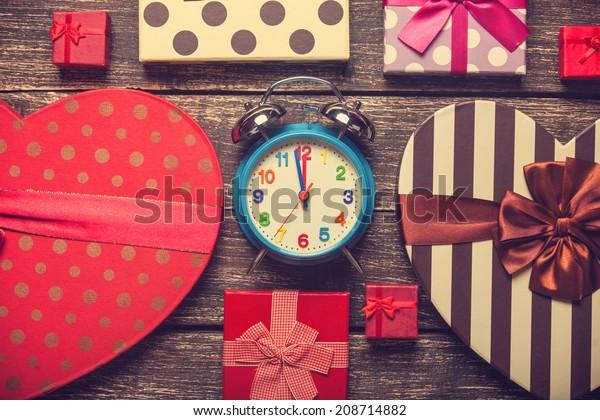 Retro alarm clock and christmas gifts around