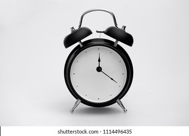 Retro Alarm Clock Isolated Showing time of after 12