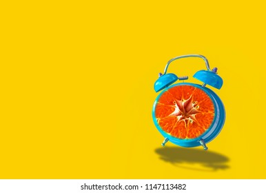 Retro Alarm Clock Pink, orange dial with slides, On yellow pastel background, With the concept of color, simplicity and fun time going forward, With copy space.