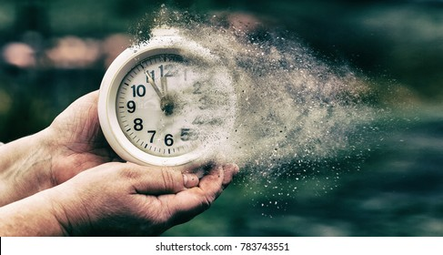 Retro alarm clock or vintage alarm clock in old hand. Time is running out concept shows clock that is dissolving away into little particles - Shutterstock ID 783743551