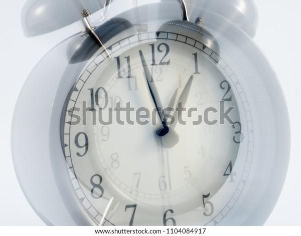 Retro alarm clock  zoom effect motion blur isolated on white background