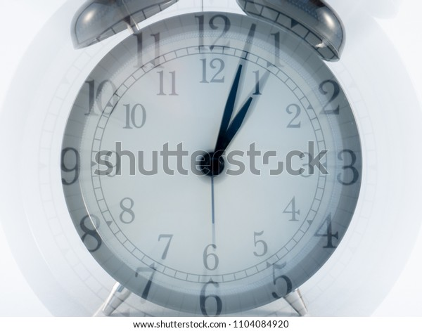 Retro alarm clock  zoom effect motion blur isolated on white background