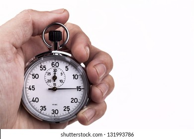 Retro analog stopwatch in a hand pointing on 15 seconds isolated on white background