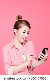 Retro asian business woman in colorful shirt Laughing and touching a smartphone, beauty face, pink background.