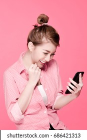 Retro asian woman successful social media marketers and holding a smart phone, beauty face, pink background.