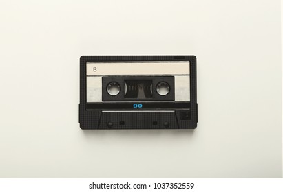 Retro audio cassette tape isolated on white background. Top view on vintage media device, copy space