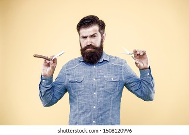 Retro barbershop. Hipster with old tools. Designing haircut. Fresh hairstyle. Barbershop concept. Care for men. Barbershop salon. Personal stylist. Vintage barber. Bearded man hold razor and scissors.