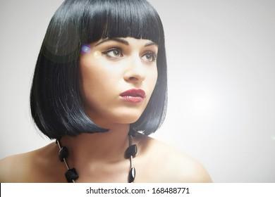 Retro Beautiful Brunette Young Woman.bob Haircut.red lips.beauty model