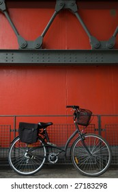 Retro bicycle against a 19 century urban environment