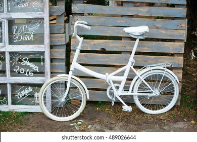 Retro bicycle on roadside with vintage style wall background
