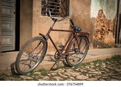 Retro bike on cobblestone streets of Cuban town Trinidad
